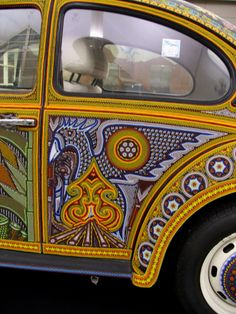 Vochol Huichol Art on Wheels.  Photograph was taken by Lighthouse Photography when it was on display at DIA.