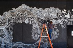 Growing Graffiti: Seed Bomb Mural--  -amazing idea and story!! She painted her mural with clay and seeds. As time passes, the clay dries and seeds fall into already prepared compost container. With time, the mural itself changes along with what sprouts!!