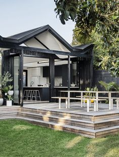 The distinct roofline of Pleated House not only pays homage to midcentury architecture, but also makes room for clerestory windows that flood the interiors with light. Style Villa, Living Style, Weatherboard House, Queenslander, Clerestory Windows, Melbourne House, Australian Homes, Outdoor Living, Outdoor Decor
