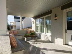 A covered porch gives homeowners the opportunity to enjoy the outdoors, rain or shine.