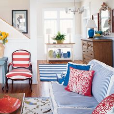 Don't be bashful―go ahead and mix stripes with patterns. Remember: Reds will dominate and blues will recede, so be judicious when placing reds throughout your home. Use them as vibrant accents, and let blue tell the story.