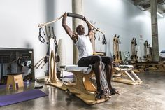 Mr. Lewis uses the Gyrotonic machine to improve flexibility and range of motion.