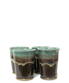 Wheel thrown stoneware tumblers glazed with saturated iron and robin's egg glazes. Electric fired to cone 5 with a 30 minute hold.  Created by Ann Augustin Pottery, Frisco, TX.