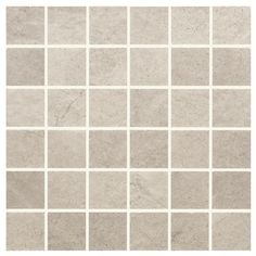Quebec Gris Porcelain Mosaic. Perfect for a wet-room floor, it has accompanying larger format floor tiles for the rest of the bathroom. Available in other shades. Pair with rustic white brick wall tiles for a stunning mix of old and new.
