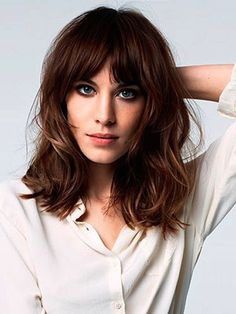 Loose curls - Loose curls for medium hair.  Curly medium hair with parted bangs.