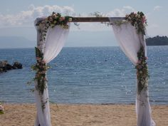 Wedding Arch in the sand!  #arch #arches #weddingceremony #flowerdesign #archinthebeach #weddingarch #corfu #αψιδα #γαμος #γαμοςστηνπαραλια #λουλουδια #κερκυρα #rizosgarden