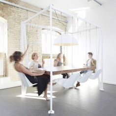 Floating table with integrated chandelier and 8 independently swinging chairs - only $11,000