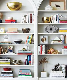 """Home Staging Tip: """"Remove 25 percent of your books entirely, and then rearrange what's left so that some books are vertical and some are stacked horizontally,"""" says interior designer Christina Salaway."""