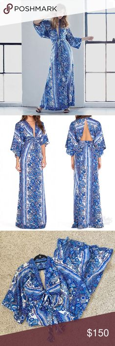 """NWT Tularosa Rosella Maxi Dress Blue XS Super cute & new with tags Tularosa rosella maxi dress in a size XS. All over print with a deep v-neck, open back, and kimono sleeves. Hidden front zipper closure is hidden with front bow tie. Waist measures 12.5"""", bust - 14.5 and length is 58"""". Sold out on Planet Blue & Revolve Tularosa Dresses Maxi"""