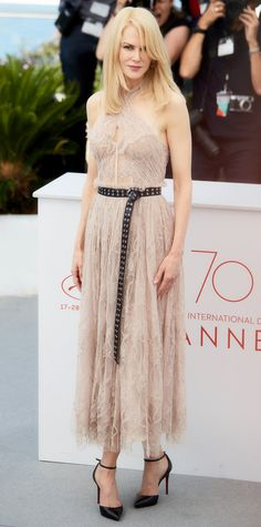 Nicole Kidman wore a gorgeous semi-sheer lace and beaded dress featuring a corset-inspired bodice and halter neckline. Kidman teamed it with a leather belt and sharp heels for an added edge.