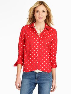 Simple in a polka-dot, red finish - our crisp button-down easily transitions from office to after-hours.