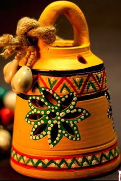 This hanging bell is made of terracotta, brought to you from Uttar Pradesh and decorated with the Warli art, native to the tribals of Maharashtra. It is handpainted with acrylic colours in yellow. Diy Home Crafts, Clay Crafts, Handmade Crafts, Arts And Crafts, Diya Decoration Ideas, Diy Diwali Decorations, Art N Craft, Diy Art, Terrace Decor