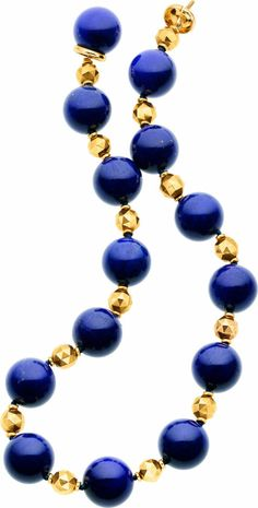 Lapis Lazuli, Gold Necklace The necklace is composed of round-shaped lapis lazuli beads measuring 21.00 x 22.00 mm, enhanced by faceted 18k gold beads and polished spacers, forming a single knotted strand, completed by an 18k gold clasp. Gross weight 191.60 grams. Length: 19 inches