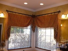 Assymmetrical Moreland valances mounted on rods and rings
