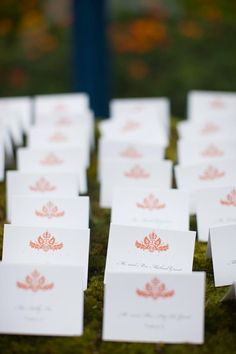 Coral and white wedding place cards