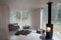 The living area of Petteri Knudsen's small house on a lake in Finland is furnished simply, with a custom-made sofa by the Finnish designer Harri Koskinen ($2,750)