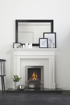 Complement monochrome living with a sleek chrome electric fire and white surround. Complement monochrome living with a sleek chrome electric fire and white surround. New Living Room, Home And Living, Living Room Decor, Wooden Fireplace, Fireplace Design, Fireplace Mantel, Fireplace Suites, Hanging Fireplace, Fireplace Ideas
