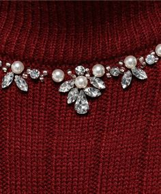 Beading around a sweater neckline