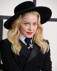 Pin for Later: Madonna's Beauty Style Is as Classic as Her Music 2014 At the 56th Grammy Awards, Madonna wore her hair in loose waves under a wide-brimmed hat.