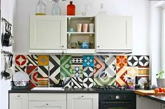 Small apartment kitchens are ideally suited for this bold patchwork tile treatment. Far more fun than tiny mosaics, this ...