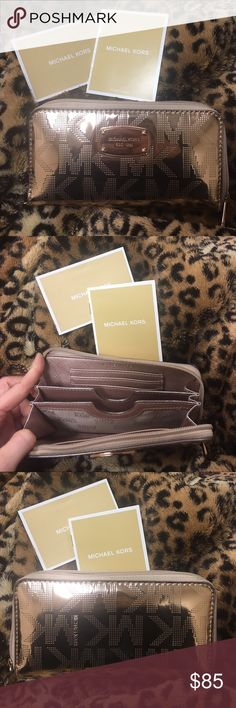 Micheal Kors wallet Micheal Kors wallet Rose Gold comes with care card and bag that it came in great condition! No stains Michael Kors Bags Wallets