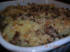 Old-Fashioned Potato-Beef Casserole. I added sliced baby carrots to the beef/onion and mashed the potatoes instead of slices. Served 6. Yummy!