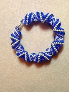 Zig-Zagging Cellini Spiral bracelet made from tutorial found on Craftsy. August 2015 15/0 7379 sapphire s/l 15/0 5218 Crystal AB 11/0 2937 white opaque  11/0 261 blue AB 8/0 and 11/0 023 sapphire transparent 8/0 and 11/0 F470 silver frosted