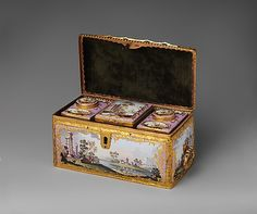Tea casket and caddies ca. 1770, British. Containing two canisters for tea (green and black) and a larger one for sugar, this chest could be locked to secure its valuable contents. The polychrome pastoral scenes and Italianate landscapes, combined with Rococo-style gilding against a pink ground, create an opulent effect.
