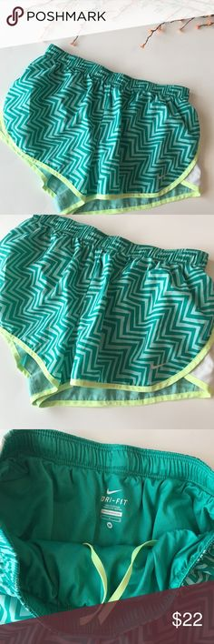 Nike | teal and green herringbone patterned shorts NWOT Nike athletic teal and green herringbone patterned athletic workout running shorts. Great for exercise! Feel free to ask questions or make an offer! Nike Shorts