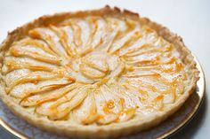 Delicate and delicious pear tart, thinly sliced Bosc pears arranged over frangipane almond paste, glazed with apricot jam, in an all-butter crust.