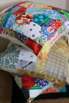 stack of luxurious cushions. new obsession with recycled patchwork. contemporary. practical. useful. vintage fabric and textiles. rainbow colours. orange patchwork cushion cover. blue patchwork cushion cover.