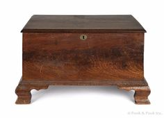 """Realized Price: $14220  Miniature Pennsylvania walnut blanket chest, ca. 1790, the interior retaining its original wallpaper surface, with a till and secret drawers, 11 1/4"""" h., 18 1/2"""" w. Provenance: Philip H. Bradley Antiques; Lee Nichols; Wistar Family"""