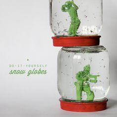 WHAT YOU WILL NEED:glass jars with lidspaintpaintbrushheavy duty glue dotsteeny tiny figurinestinsel glitterwater  INSTRUCTIONS:1. Gather your supplies.2. Paint the lids, let dry.3. Use glue dot (we use ZOTS) to adhere figu