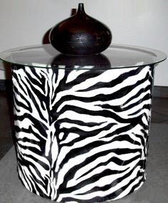 "Zebra Fiero End Table  Fiero (Wild) Beautiful Glass Top Table .       Faux Fur Tubular Base, with a solid black top.  Elegant look, perfect for an end table in the living-room, or the bedroom.    Approximately: 15"" Tall.  Glass Top 19¼"" Diameter.  $230.00"