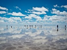 The reflective surface of the world's largest salt mine is like something from…