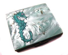 WANT!!!!! 1950s metal compact with lucite top. In aqua. With a freakin GLITTERY SEAHORSE!!!!