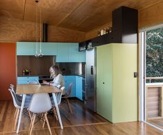 The bach's refurbished interior was brightened up with a mid-century-inspired colour palette. Photograph by Paul McCredie Reclaimed Kitchen, Inside Home, House And Home Magazine, House Tours, New Zealand, Mid-century Modern, Beach House, House Plans, New Homes