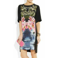 Stella McCartney Silk Hawaiian Print Shift Dress Black and pink-multi Hawaiian print dress. Black twill trim throughout. Short sleeves and rounded neckline. Slits at the sides with a slightly longer hemline at the back. Loose, straight silhouette. Solid black reverse. 100% Silk. Material II: 59% Acetate, 41% Silk. Material III: 100% Viscose. Dry clean.Labeled Italian Size?36 (according to sizing?charts, this converts to a US Size?0 - 2)this is a relaxed shift style!??Length from mid-shoulder…