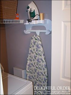 Delightful Order: Small Laundry Room Solutions- Holder for ironing board... Cool