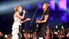 "Before Keith Urban and Carrie Underwood picked up their trophy for their Collaborative Video of the Year win at the 2017 CMT Music Awards, they joined forces for a mostly stripped down live version of the winning tune, ""The Fighter."""