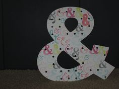 You can't say the alphabet without an ampersand. This one is decorated with sb paper.
