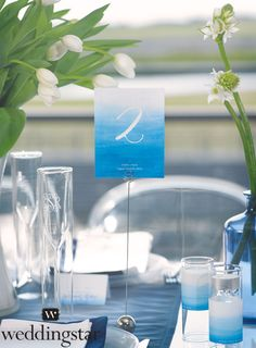 Make your wedding table numbers pop with our Aqueous Table Numbers - with customization option! {blue, waves, aqua, ocean, wedding theme, wedding colors, table setting, tablescape}