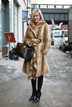 Fur coat and black Hermes bag