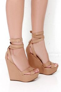 """Step into a whole new caliber of cute in the Another Level Natural Platform Wedges! Smooth nude vegan leather crisscrosses over the toe and wraps three times around the ankle with an adjustable gold buckle. A stunning 5.5"""" wedge heel rises 1.5"""" at the toe. Lightly cushioned insole. Nonskid rubber sole. Available in whole and half sizes. Measurements are for a size 6. All vegan friendly, man made materials."""