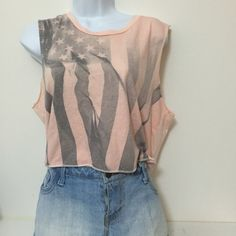 "American flag muscle crop top A faded American flag on a ballerina pink crop top. Muscle tank style because long cuts on the under arm. There aren't seams on the edges. Great condition tank! 18"" from shoulder to bottom, 21"" from armpit to armpit.   Save on shipping when you bundle!  20% off 2 items or more   No trades or negotiating prices in comments American Eagle Outfitters Tops Crop Tops"