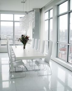 the lighting above the table...@ All-white minimal dining room sizzles with glam