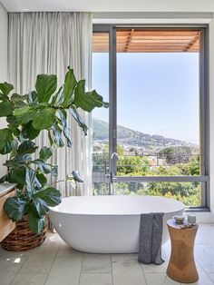 The renovation of this interior designer's home in Cape Town has changed it from a fragmented space into a spacious family refuge. Decor, Home, Renovations, Bath, House, Spacious, Clawfoot Bathtub, Interior Design, Love Decor