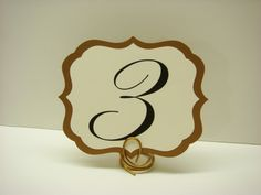 Table Numbers Elegant Vintage Label Design with a Romantic Script Font Prepared in Colors of your Wedding Reception Decor. $2.50, via Etsy.