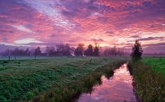 Canal and Pink Clouds at Sunset