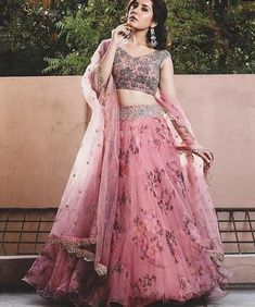 You can be assured to make a great style statement with this pink floral print organza lehenga. This lehenga is enhanced with fancyprint and lace border work .Buy this latest designer lehenga choli online .Paired with matching choli and dupatta Indian Fashion Dresses, Indian Gowns Dresses, Dress Indian Style, Indian Designer Outfits, Maxi Dresses, Saree Fashion, Indian Bridal Fashion, Pakistani Dresses, Bollywood Fashion